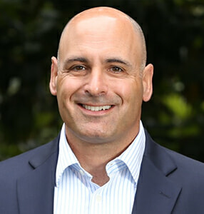 Headshot of Global 1's COO, Mike Caponnetto