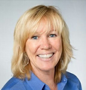 Headshot of Global 1's Director of Operations, Sandra Souter